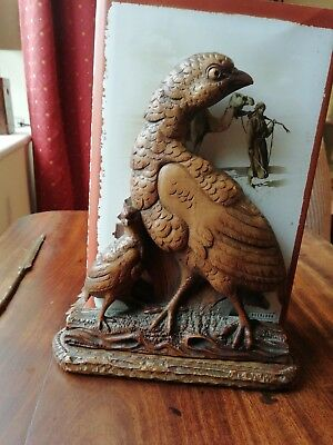 Black Forest carved wood bookrack book case featuring partridge.