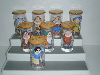 G113  Set of 8 IXL Snow White & the 7 Dwarfs Glasses with Lids 2004 ?