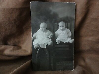 RPPC Real Photo Postcard Of Two Adorable Twin Babies sitting for a Photo in 1916