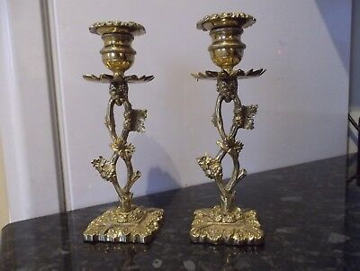 antique pair of solid cast polished brass ornate candlesticks,