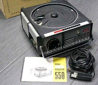KODAK CAROUSEL 35mm Slide Projector 550 w/Zoom Lens Remote & Box WORKS GREAT