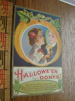 Antique Halloween post card- embossed woman's face inside pumpkin