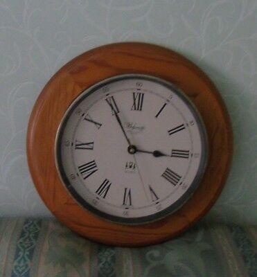The Belgravia Carriage Clock Co London Quartz wall clock  light wood surround