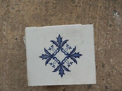 Mintons China Works Tile with stylised floral pattern. Blue on white