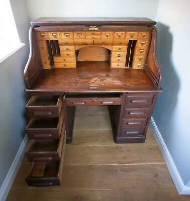 Antique roll top oak/maple pedestal desk with many drawers