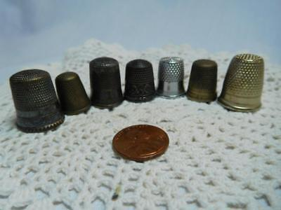 7 Antique metal, silver , raised designs, sewing THIMBLES
