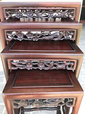 Antique Chinese wooden carved nest of 4 tables