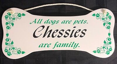 """All dogs are pets.  Chessies are family.""  Wall Plaque/Sign"
