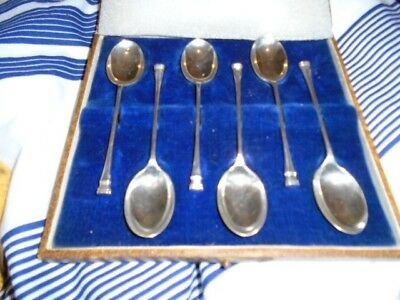 two sets of silver coffee spoons in cases