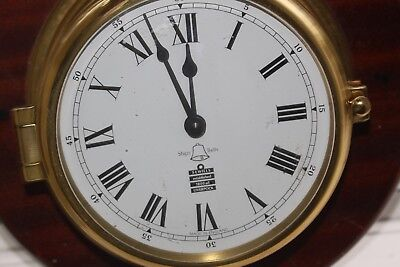 A Sewills of Liverpool Ships Bell Brass porthole Clock Made in England (8 Bells)