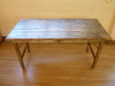 A Rustic Timber Trestle Table.
