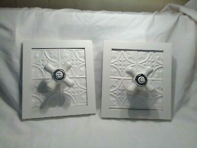 Vintage Hot and Cold Faucet Knobs on White Deco Board Towel Holders