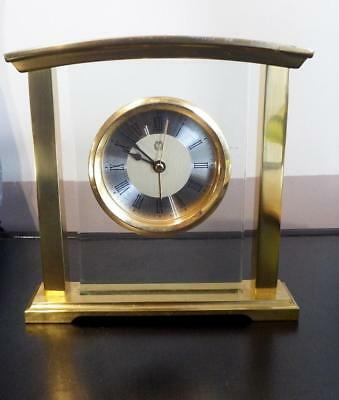 Vintage mantel battery alarm clock set in thick glass with brass surround