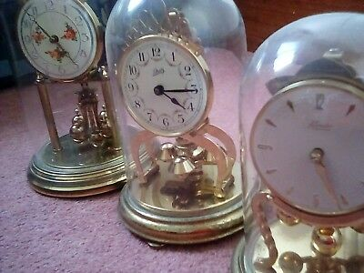 job lot of old glass dome mantle clocks