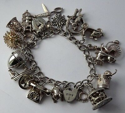 Fantastic heavy vintage solid silver charm bracelet & 19 charms, rare open,move