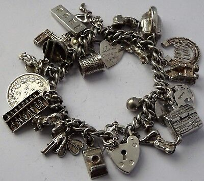 Lovely heavy vintage solid sterling silver charm bracelet & 25 charms, open,move