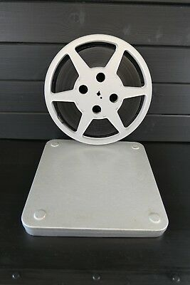 Large metal film reel and tin, vintage movie can and full spool of film, 16mm