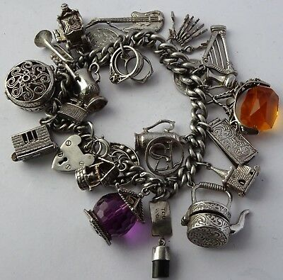 Superb heavy vintage solid silver charm bracelet & 23 charms,rare,open,move.104g