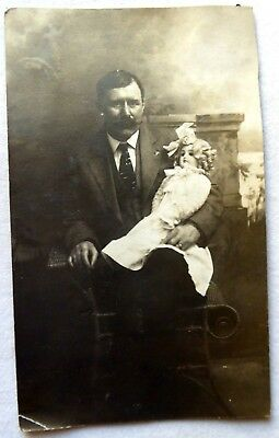 Antique Real Photo Postcard Of A Man Holding Life Sized Child's Doll