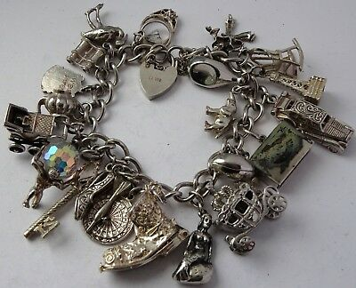 Stunning heavy vintage solid silver charm bracelet & 23 charms,rare,open,move