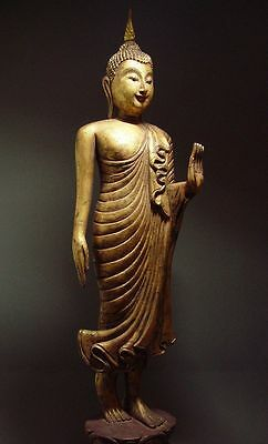 ANTIQUE WOOD-CARVED AYUTTHAYA WALKING BUDDHA (72.39cm). 18th CENTURY.