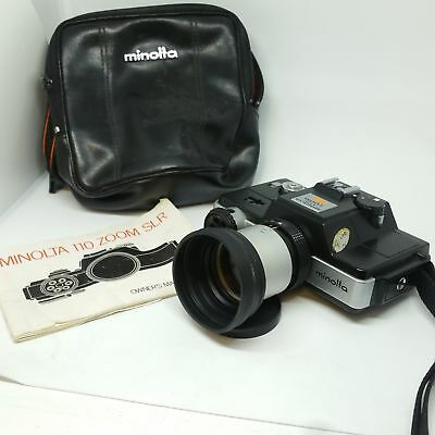 Minolta 110 Zoom SLR with manual and soft pouch