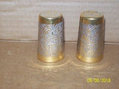 "Gold tone salt & pepper shakers with embossed floral design 2"" tall, Porcelain?"