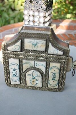 old islamic brass metal and bone saddle bag, with Arabic numbers