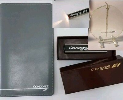 Air France Concorde collectibles, Infuser , check book cover and a flash light.