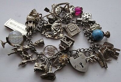 Stunning vintage solid silver charm bracelet & 28 charms, rare, open,move. 88.4g