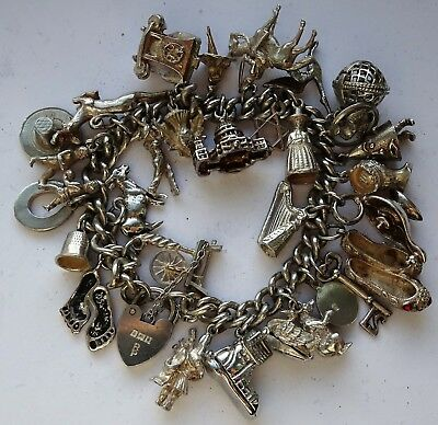 Wonderful vintage solid silver charm bracelet & 30 charms, rare,open,move. 88.9g