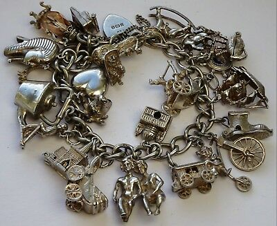 Stunning vintage solid silver charm bracelet & 23 charms, rare,open,move. 82.6g