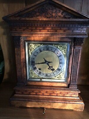 A beautiful antique 8 day Westminster chiming clock in mahogany.