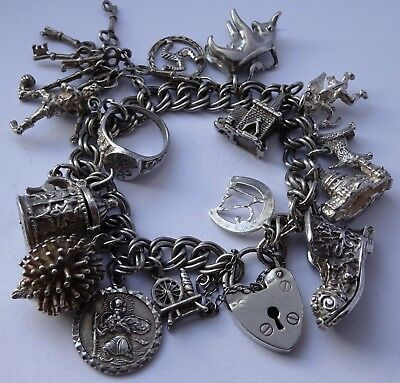 Beautiful vintage solid sterling silver charm bracelet &15 charms, open, moving
