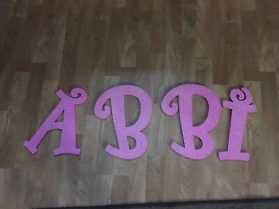 """Pink Wooden letters """"ABBI"""""""