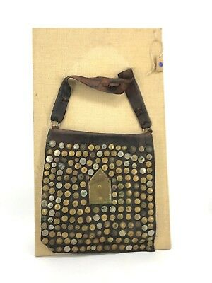 VINTAGE MOROCCAN WATER BAG STUDDED WITH COINS (MOUNTED ON 37 x 22 BURLAP FRAME)