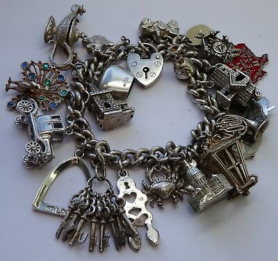 Gorgeous vintage solid sterling silver charm bracelet & 21 charms, open,moving