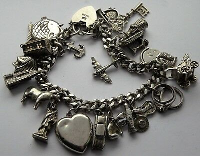 Lovely vintage solid sterling silver charm bracelet & 21 interesting charms.1965
