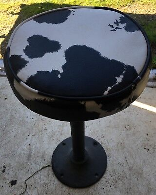 Vintage stools with cow pattern seat (set of 4)