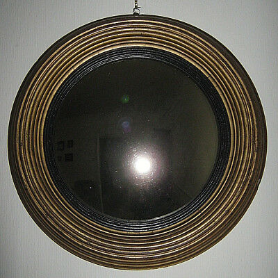 Early 19th century giltwood convex mirror with ebonized slip