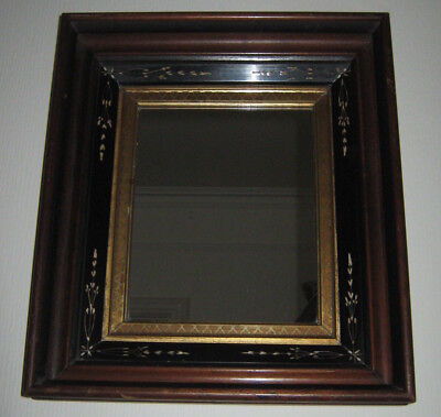 Regency Rectangular mirror with incised black lacquer and gilded slip borders