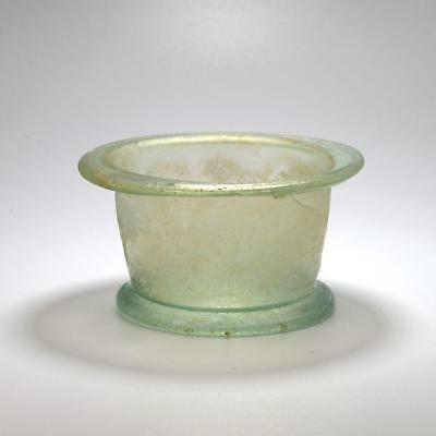 A Roman Green Glass footed Bowl, Roman Imperial, 1st Century AD