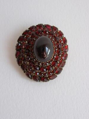 Antique Victorian gold plated Bohemian garnet cabochon brooch / pendant