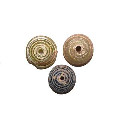 * A set of three Roman Glass Spindle Whorls, Roman Imperial Period, ca. 3rd Cent