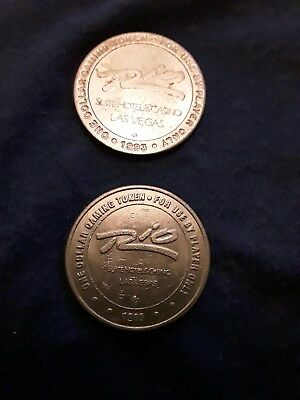 TWO $1 Slot Gaming Tokens 1989 and 1993 Rio Suite Hotel Casino Las Vegas Nevada