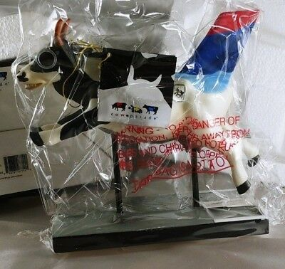 Cow Parade #7711 Platinum Moodallion - RETIRED AND RARE -HAND NUMBERED #1E/3.747