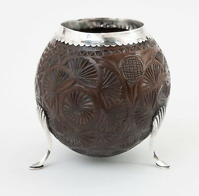 An Antique Carved Coconut Cup Mounted with Reeded Silver Feet c1800