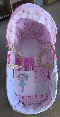 Baby Girls Pink Moses Basket With Rag Doll Design And Wooden Rocking Stand