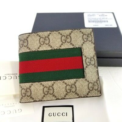 a91ea74f8e3fb1 New Authentic Gucci Mens Web Beige/ebony GG Supreme canvas Bi fold wallet w/