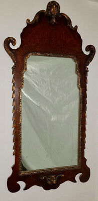 A Georgian walnut parcel gilt carved style mirror English, Circa 1880